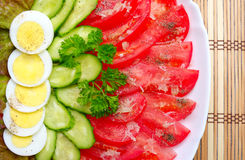 Salad on wooden mat Royalty Free Stock Photos