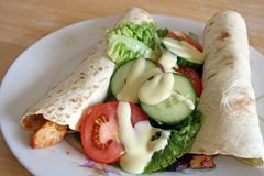 Salad and wraps Royalty Free Stock Photos