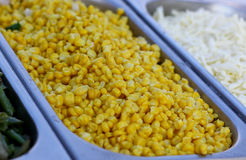 Salad from  yellow maize corn beans on try. Fresh vegetable  salad from yellow maize corn beans on a  fast food sale plate, selective focus, close-up Royalty Free Stock Images