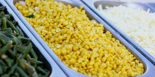 Salad from  yellow maize corn beans on try. Fresh vegetables bar salad from yellow maize corn beans on a  fast food sale plate, selective focus, close-up Stock Images
