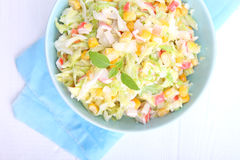Salad of young cabbage with corn and crab sticks Stock Photos