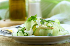Salad of zucchini, cucumber and  cheese Royalty Free Stock Photo