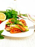 Salad with zucchini and tomato on board Stock Photography