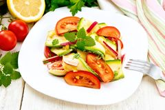 Salad with zucchini and vegetables on board Royalty Free Stock Photo
