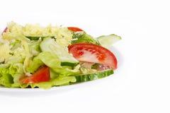 Salada clara do verão no fundo branco Fotos de Stock Royalty Free