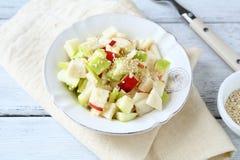 Salada com maçãs e aipo em uma placa Imagem de Stock Royalty Free