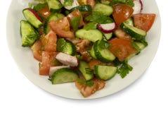 Salada com pepinos e tomates Imagem de Stock