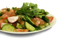 Salada com pepinos e tomates Imagens de Stock Royalty Free