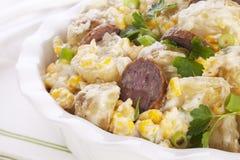 Salada da batata com salsicha e milho Imagem de Stock Royalty Free