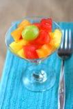 Salada da fruta com forquilha fotografia de stock