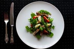 Salada da rúcula e da carne do tomate Imagem de Stock Royalty Free