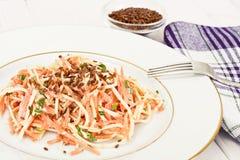 Salada da raiz ou o rabanete de aipo, a cenoura e o iogurte natural Fotografia de Stock