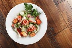 Salada de Caesar com salmões Foto de Stock Royalty Free