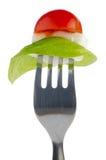Salada de Caprese na forquilha Foto de Stock Royalty Free