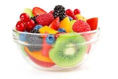 Salada de fruta isolada no branco Foto de Stock