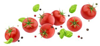 Salada de queda dos tomates isolada no fundo branco com trajeto de grampeamento, ingrediente de voo dos legumes frescos fotografia de stock royalty free