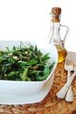 Salada de Rucola e petróleo verde-oliva imagens de stock royalty free