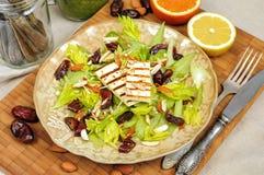 Salada do aipo com datas, amêndoas e queijo Fotografia de Stock