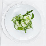 Salada do pepino em uma placa Imagens de Stock Royalty Free