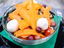 salada dos tomates de cereja com fim da cenoura acima fotografia de stock royalty free