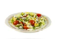 Salada dos tomates de cereja e da alface de iceberg foto de stock royalty free