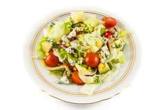 Salada dos tomates de cereja e da alface de iceberg imagens de stock