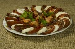 Salada dos tomates de tipos escuros Foto de Stock