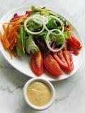 Salada e pingamento Fotos de Stock Royalty Free