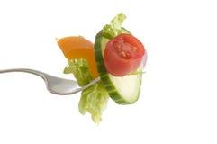 Salada em uma forquilha fotografia de stock