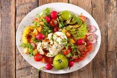 Salada misturada com tomate Imagens de Stock Royalty Free