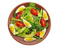 Salada verde com rúcula, espinafres do bebê, abacate isolado fotos de stock