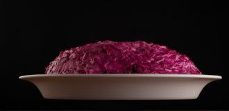 Salada vermelha no fundo preto Imagens de Stock Royalty Free