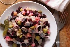 Salade avec des harengs. Photo stock