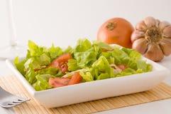 Salade de tomate et de laitue. Photos stock