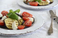 Salade with egg plant and tomato Stock Images