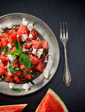 Salade fraîche avec la pastèque, le feta, la chaux et la menthe photographie stock