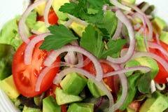 Salade jetée en l'air délicieuse Photographie stock libre de droits