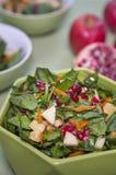 Salade mixte avec la grenade Photographie stock libre de droits