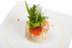 Salade Olivier decorated with shrimps and red caviar Royalty Free Stock Image