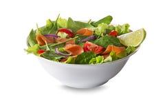 Salade saumonée avec de la laitue d'isolement sur le blanc Photographie stock