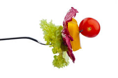 Salade sur une fourchette Photo stock