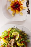 Salads. Delicious green and fruit salads Stock Photo