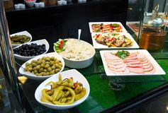 Salads and appetizers, Banquet table with delicious festive food stock photography