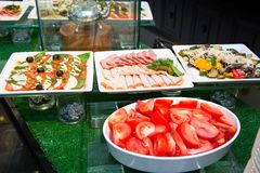 Salads and appetizers, Banquet table with delicious festive food royalty free stock photos