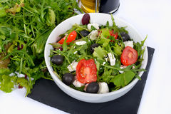 Salads with bottle of oil Royalty Free Stock Image