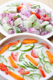 Salads in bowl with dressing Stock Photos