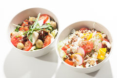 Salads in the bowl on the white background. Salads in the oval bowl on the white background Royalty Free Stock Images