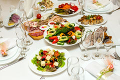 Salads and cold cuts at the banquet table Stock Photo