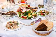 Salads and cold cuts at the banquet table Stock Photos