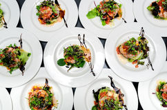 Salads in Dishes. Top view of dishes with contemporany salads for a banquet Stock Images